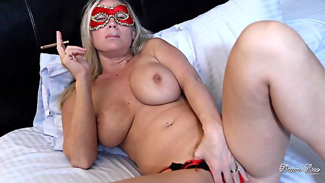 Devon Lee wears a mask while sucking and titty fucking a guy