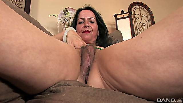 Nina Swiss penetrates her own experienced pussy with a toy