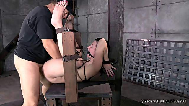 Gagged woman spreads her legs for a couple of hard dongs