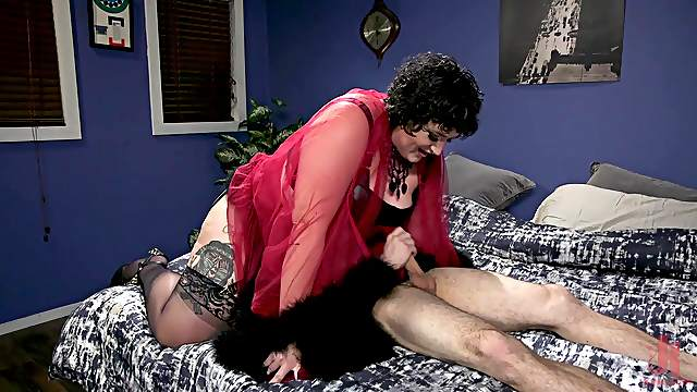 BBW mistress Mimosa abuses a skinny guy with her feet in nylons