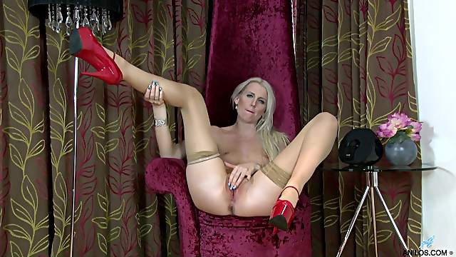 Video of solo blonde cougar Lexi Lou in a provocative red dress