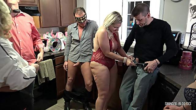 Swinger housewives eating fat cocks at orgy