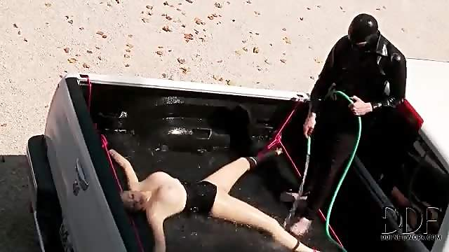 Daring babe in full body latex suit gets submerged in water