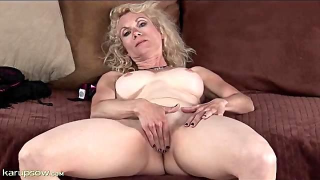 Masturbating mature has incredible big tits