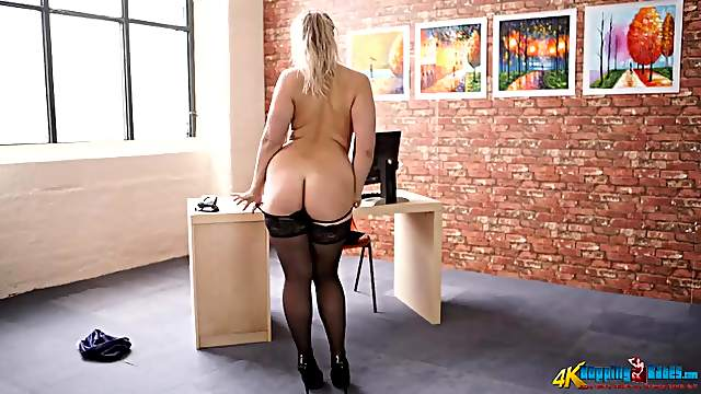 Curvaceous secretary in a stunning striptease