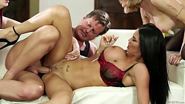Three beautiful sluts service the dicks of two men in an orgy