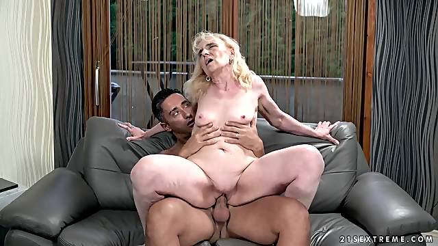 Granny sits her shaved pussy on a hard cock