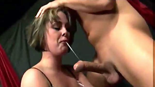 Pumping her mouth and making her choke on it