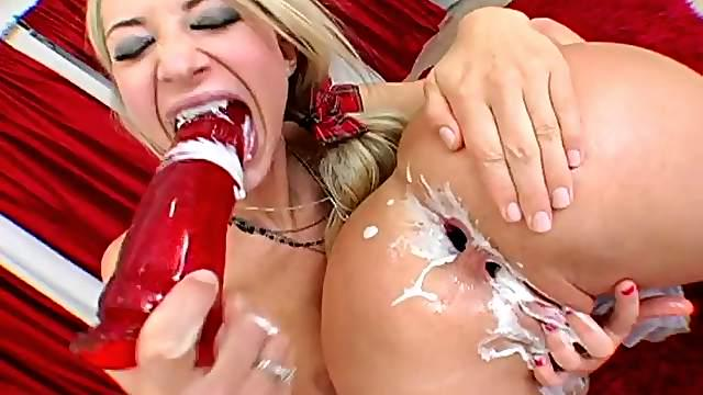 Flirty lesbian couple fucking with anal toys in messy fetish shoot
