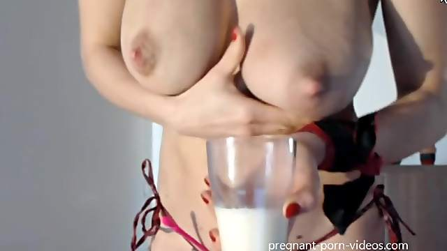 Lactating amateur have very much milk in her hot breasts