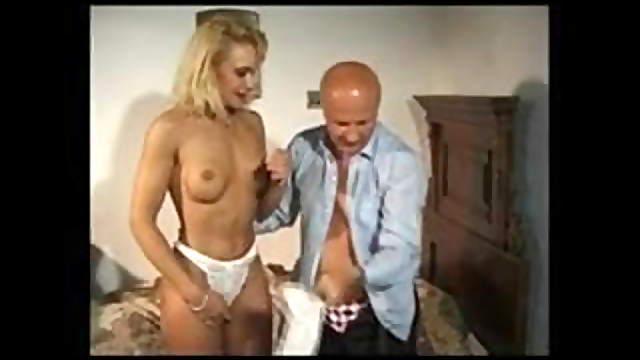 Bald man with tall blonde hooker