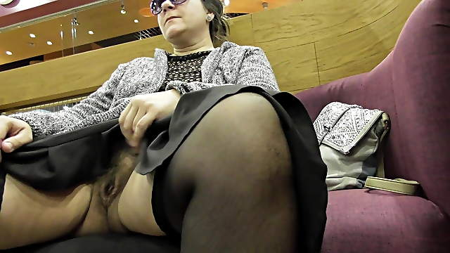 Mature with hairy pussy flashing in mall