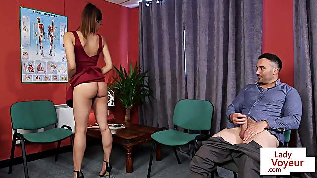 Asian babe teasing man in doctor office