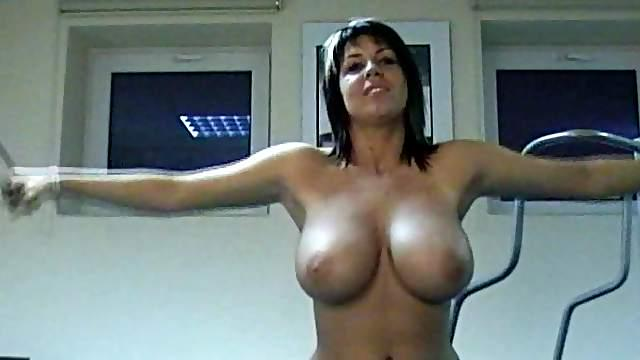 Busty babe in the gym showing off her huge natural tits