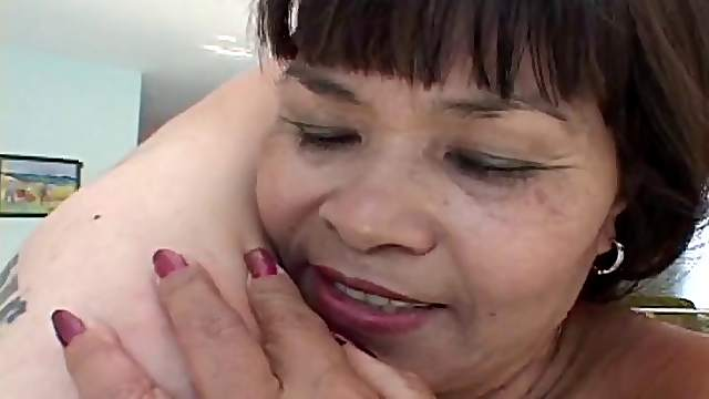 Small titted mature Asian in black stocking fucked standing