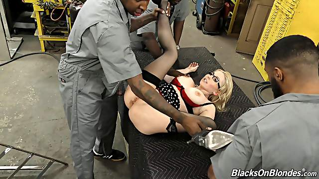Blonde milf in glasses giving a blowjob as she gets drilled in gangbang