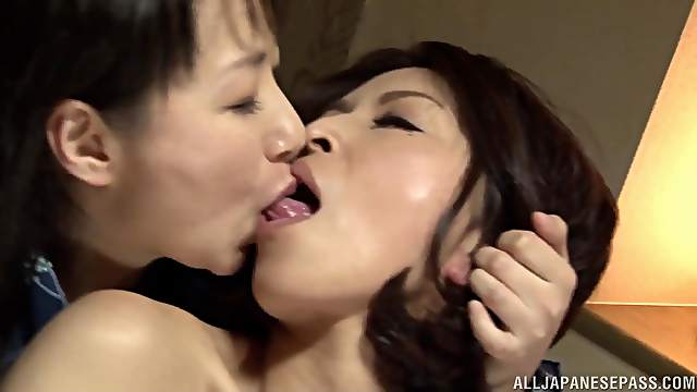 Passionate lesbian lovemaking between two sexy Japanese babes
