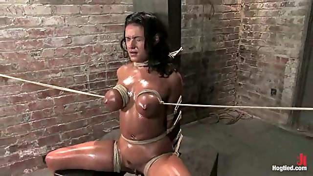 Charley Chase moans loudly while being tormented by Lochai in BDSM scene