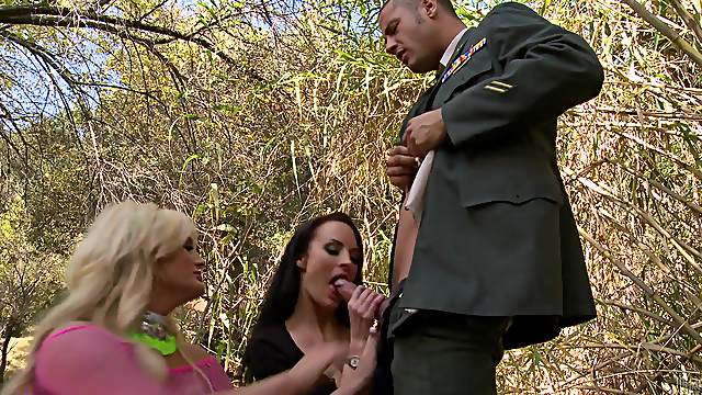 A military man ends up having a threesome with two hotties outdoors