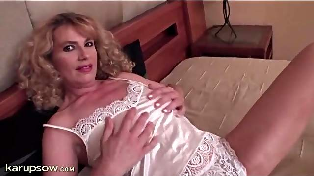 Mature in satin strips and toys her hairy cunt