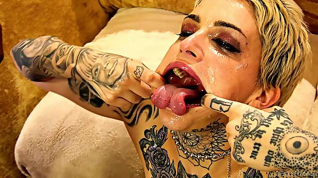 Black men wreak havoc on tattooed harlot Leigh Raven's cunt