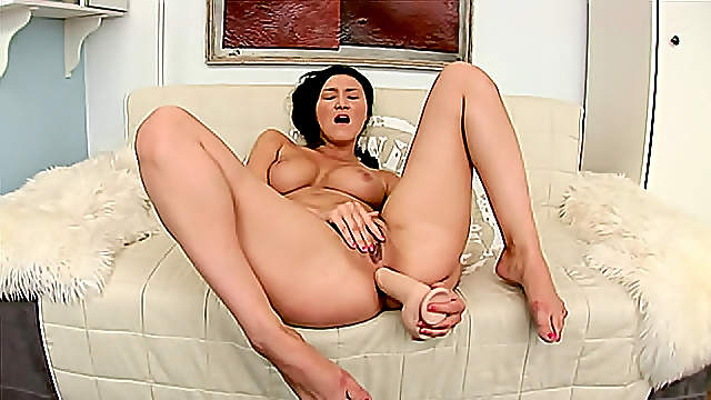 Dildo up the ass of the curvy brunette