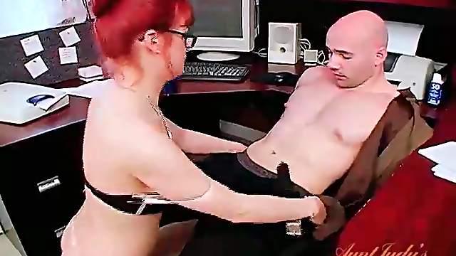 Secretary in stockings sucks cock in the office