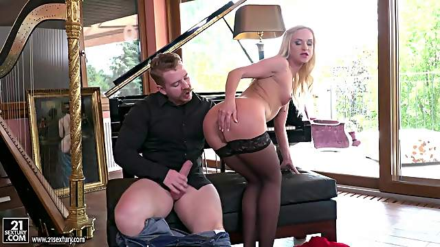 Blonde beauty Vinna Reed sucks cock in stockings