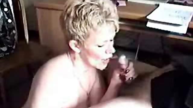 Mature wife on her knees sucks dick